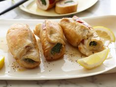 Chicken Saltimbocca : Thinly pounded chicken cutlets get layered with prosciutto, spinach and Parmesan before being rolled up and secured with toothpicks. These make an elegant and flavorful main course.