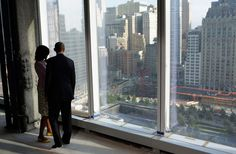 U.S. President Barack Obama and first lady Michelle Obama look down at the 9/11 Memorial while touring the One World Trade Center building in New York, on June 14, 2012. (Reuters/Kevin Lamarque)