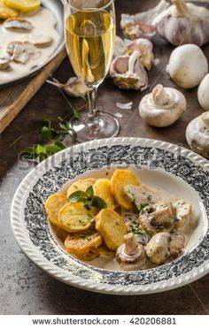 Mushroom sauce with roasted potatoes, lots of herbs for best flavour
