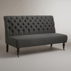 A gently rounded back and plush tufting create instant drama in our Gray Linen Harper Banquette. Crafted from espresso-finished Chinese cherry wood with linen upholstery in gray, it makes a sophisticated seating option for dining or entertaining.