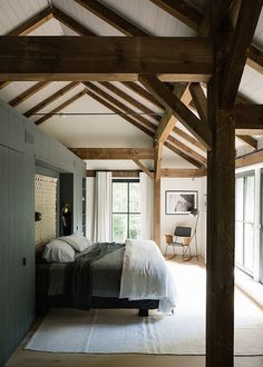 Cozy bedroom with high ceilings and wooden beams rustic barn homes, modern rustic homes, Rustic Barn Homes, Modern Rustic Homes, Modern Farmhouse, Cozy Bedroom, Bedroom Decor, Modern Bedroom, Master Bedroom, Passive House, Deco Design