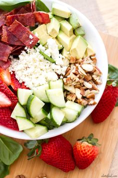 This easy salad is packed with the works: strawberries, avocado, turkey bacon, feta cheese, pecans, almonds and cucumbers over a bed of spinach.