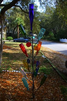 """I just love bottle trees - """"the poor man's stained glass""""! Love this colorful and graceful bottle tree! Wine Bottle Trees, Wine Bottle Wall, Lighted Wine Bottles, Bottle Art, Glass Bottles, Garden Whimsy, Garden Art, Garden Ideas, Barn Parties"""