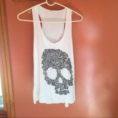 White flower skull muscle tee White flower skull muscle tee. Never worn & in great condition!! Pairs great with a bandeau underneath. Tops Muscle Tees