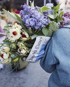 big bunch of flowers wrapped in newspaper