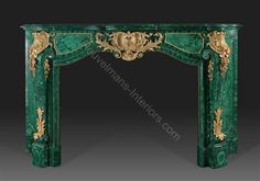 www.heuvelmans-interiors.com    Gilt bronze and malachite veneered fireplace mantle style Louis XV   Model by ABJ cheminees and bronzes made by Heuvelmans Interiors
