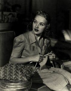 Betty Grable knitting on set