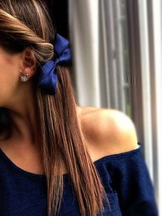 Dress up an off the shoulder top with a matching bow + sparkly earrings.