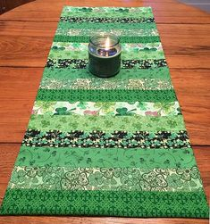 Simple St. Patrick's Day Table Runner -Give your dining table a decorative treat with this simple St. Patrick's day table runner. The table runner would be perfect for the holiday feast. With six different fabrics, you can design the pattern you like. This table runner is incredibly easy and inexpensive.