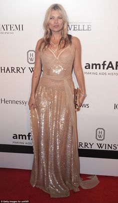 Kate Moss dazzles in racy rose gold gown at amfAR Brazil gala #dailymail