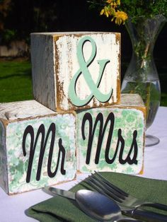 These distressed DIY Mr. & Mrs. blocks will compliment your rustic wedding decor. From @Amy Lyons: Mod Podge Rocks