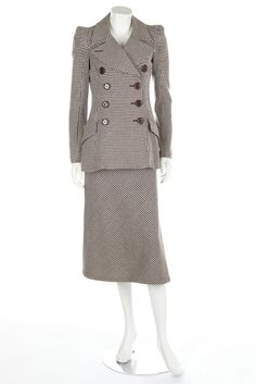 * BIBA brown and white hound's tooth checked skirt suit, 1974, printed satin label, double-breasted with large chunky buttons