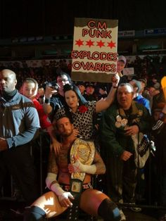 """Punk's """"Why yes, I do"""" face, plus the woman's crappy sexy face, plus the kid in the John Cena shirt touching CM Punk's shoulder and the guy in the green derping make this picture....immortal."""