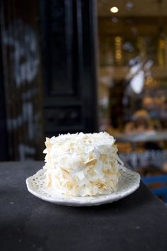 ... coconut custard, 7-minute frosting, toasted coconut flakes. Photo by