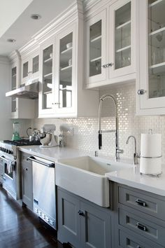 White Kitchen Cabinets Glass Doors Dark Wood Floors And Mini Subway Tile Backsplash