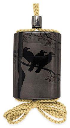 A Four-Case Inro Signed Kanshosai with kakihan, Edo Period (19th century) Decorated in black and silver togidashi-e with crows in a tree, silver ojime7.6cm. high, Christies A Sheath Inro, Edo Period (18th century), 7.7cm. high, ChristiesThe sheath decorated in gold hiramaki-e and takamaki-e