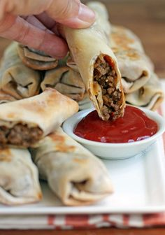 These Cheeseburger Egg Rolls are the perfect party food or came day snack for football season! Just 112 calories or 3 Weight Watchers SmartPoints! www.emilybites.com