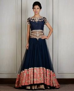 Top shirt of this Blue long jacket lehenga is made in net fabric with zardozi embroidered silk yoke. Bottom border is of contrasting orange heavily floral Tilla embroidered paner. Boat neck with slice Lehenga Designs, Indian Wedding Outfits, Indian Outfits, Indian Weddings, India Fashion, Asian Fashion, Long Jacket Lehenga, Mehndi, Indie Mode