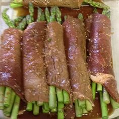 My Steak wrapped asparagus. Super easy!  Marinate thin cut steak in minced garlic, soy sauce, Worcestershire sauce and teriyaki sauce for 2 hours. Wrap 4-6 stalks fresh asparagus in the steak. Cover with aluminum foil and bake for about 30 minutes at 350.