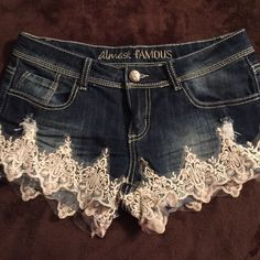 Super Cute demin shorts Denim shorts complemented with Lace and Pearls on the leg area- almost famous size 7 like new condition Almost Famous Jeans