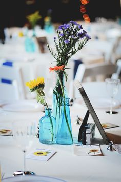 Aqua Bottle Centerpieces|{Navy Blue & Yellow} Round Barn Country Wedding|Photographer: Lauren R. H. Campbell Photography