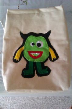 Monster felt applique on kids backpack