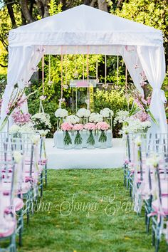 Daily Pretty: Modern and elegant bat mitzvah ceremony bimmah. Tall glass cylinders with pink carnations, pink gladiola, varietal orchids, calla lilies and white hydrangea.  Hanging glass bulbs with pink baby spray roses.  Image by Damion Hamilton
