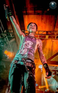 He projects an indestructible spirit on stage.  I wish he wouldn't let the trolls put a crack in his aura of pure joy and pride.   He's proving that he's everything and more then they will ever be, just by being there.  -Black Veil Brides / Andy Biersack
