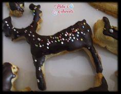 Hojaldres navideños de azúcar y cubiertos de chocolate