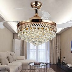 Tired of the boring ceiling fan light kits buy a sparkly flush modern crystal remote control retractable ceiling fan light chandelier lighting aloadofball Choice Image