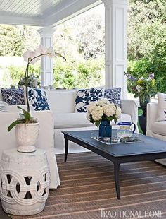Bill and Giuliana Rancic's covered porch features a classic blue-and-white palette and simple patterns.