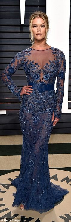 Blonde beauty! Leonardo DiCaprio's girlfriend, Nina Agdal, 24, showcased her ample assets in a sheer blue frock