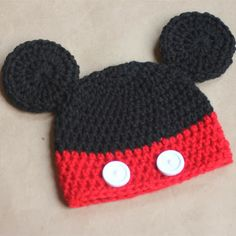 Mickey Mouse Crochet Hat Pattern. I'd add a yellow stripe on the bottom. Maybe pink and a bow for Minnie.