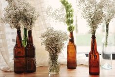 baby's breath in glass bottle, tie with thick rope.