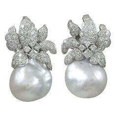 Natural Baroque south Sea Pearl and diamond Earrings | From a unique collection of vintage clip-on earrings at http://www.1stdibs.com/jewelry/earrings/clip-on-earrings/