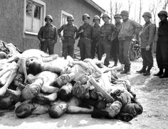 Grim-faced GIs contemplate a pile of dead bodies at the Buchenwald concentration camp in 1945. Scenes like this were repeated throughout Germany, with some GIs taking things into their own hands and summarily shooting SS guards. These incidents were (reluctantly) investigated by command without any serious penalties for those involved (my reaction would have been similar to the GIs meeting such scenes).