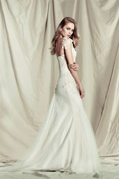 The 2014 Pallas Couture wedding dresses exude vintage opulence and are made of the finest french laces and silks.
