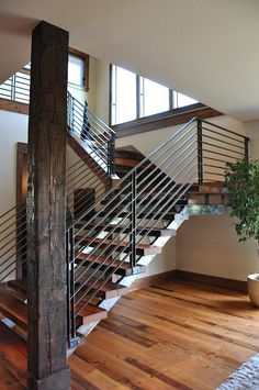 well done staircase with different wood stains and metals