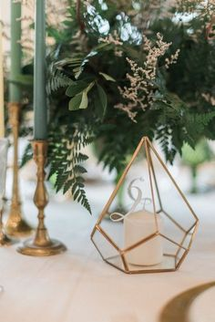 This tall gold triangle shaped glass terrarium is the perfect dramatic height on any table or accent in your home. Add flowers or lights for a warm glow. Gold Table Numbers, Wedding Table Numbers, Spring Wedding, Wedding Day, Party Wedding, Garden Wedding, Wedding Ceremony, Wedding Aisle Outdoor, Fern Wedding