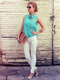 White skinny jeans with a sheer turquoise top and a stripped bandeau.