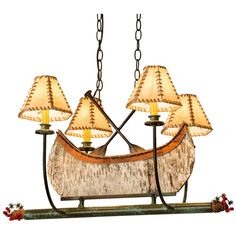 30 Inch L Canoe 4 Lt Chandelier - Custom Made. 30 Inch L Canoe 4 Lt ChandelierThis handsome 4 light Canoe Chandelier, complete with antique Copper finished steel paddles, is the perfect complement to your camp, home or lodge. Handmade in the USA by Meyda artisans, this charming fixture features a Birch Bark Canoe which is surrounded by four curved arms with Faux Raw hide-wrapped Leather hexagonal Shades that top faux candlelights on bobeches. The hardware includes Tarnished Copper…