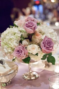 Pastel purple roses and white hydrangea centerpiece in a delicate silver mercury pedestal vase. Arizona wedding reception centerpiece by Blume Events LLC