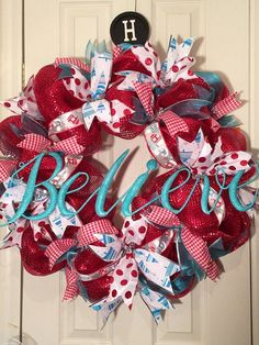 This wreath is very full and gorgeous. It is red mesh with amazing ribbons. The ribbons are red and white gingham, white with turquoise trees, mittens and red and white polkas. $54.99