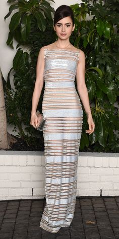 At a pre-Globes fete, Lily Collins wore her version of the naked: a see-through column striped with metallic bands.