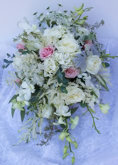 Unique, cascading bridal bouquet with orchids, roses, queen anne's lace and hydrangea | Wedding Designs by the Pod Shop Flowers, New Hope, PA