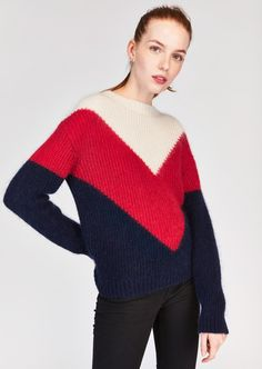 25e7f5f96b82 This cozy knit pullover features long sleeves and a high neck. We love it s  bold colorblock design and effortless ability to elevate any look to très  chic.