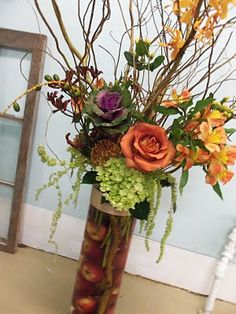 Azalea Floral Design - Flowers and apples. perfect fall centerpiece.