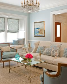 soft blues with neutrals, chandelier, sisal rug... chic elegance