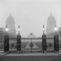 A night-time view of the wrought iron gates and gatepiers to the Royal Naval College on Romsey Road, showing the college in the mist beyond. Late This is now Trinity College of Music recently renamed Trinity Laban, Greenwich. English Heritage, Heritage Site, Greenwich London, London Boroughs, London Pictures, Wrought Iron Gates, Vintage London, Historical Photos, London England