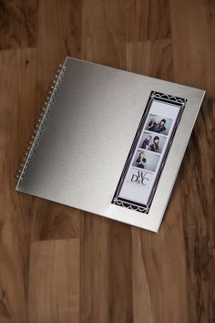 Photo booth wedding guest book. Stainless steel cover with window showing front photo strip. Modern and cool! zentnerdesign.com